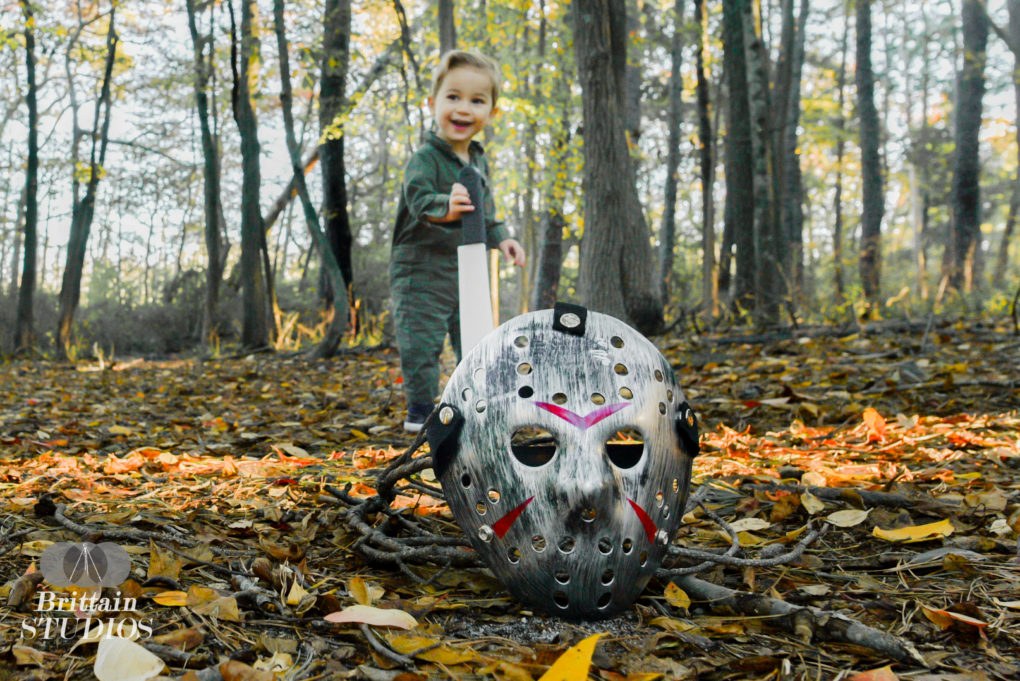 October 14th – If it were not for Leap year, today would be a Friday the 13th. So in honor of Friday the 14th, today's photo is of Jason Vorhees. It doesn't make much sense to do a photo of Charlie in a mask if you can't see his face, so we wondered for a long time how to pull this off. It occurred to us that we could have the mask sticking out of the ground in the foreground and Charlie in the background holding a machete. We were able to find a jumpsuit similar to the outfit that Jason wears in a few of the movies, and we took him to Cattus Island in Toms River. By sticking the machete out of the ground, Charlie naturally wanted to walk over and pull it out. We got his attention enough to get this great shot. Afterward, I ran around in the woods with him while wearing the mask, and we had a great time playing hide and seek behind the trees.