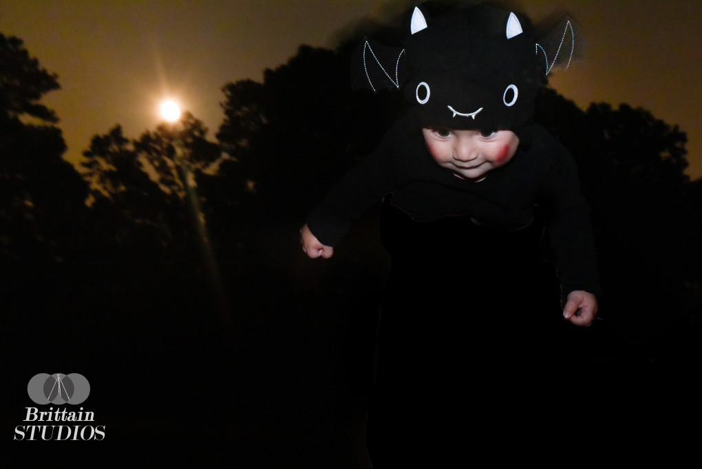 October 7th – The Bat was another tricky shot for us, because we were attempting include the full moon. After a few tries on the beach as the moon came up, we ended up finding a park with a clearing that was lit only by the moon. Dressed head to toe in black, Caroline held Charlie over her head while I adjusted the settings. Getting a clear shot of the moon with a moving baby in the foreground is no easy task, but we got a shot we were happy with, and Charlie seemed to enjoy the ride as well.